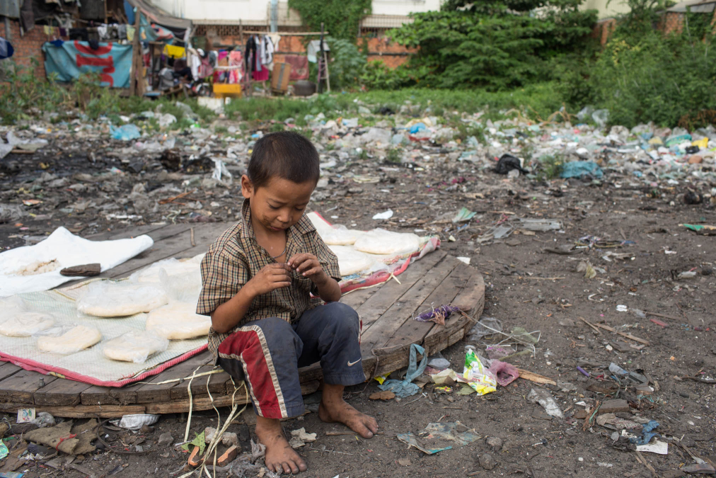 Boy at home in slums of Phnom Penh.