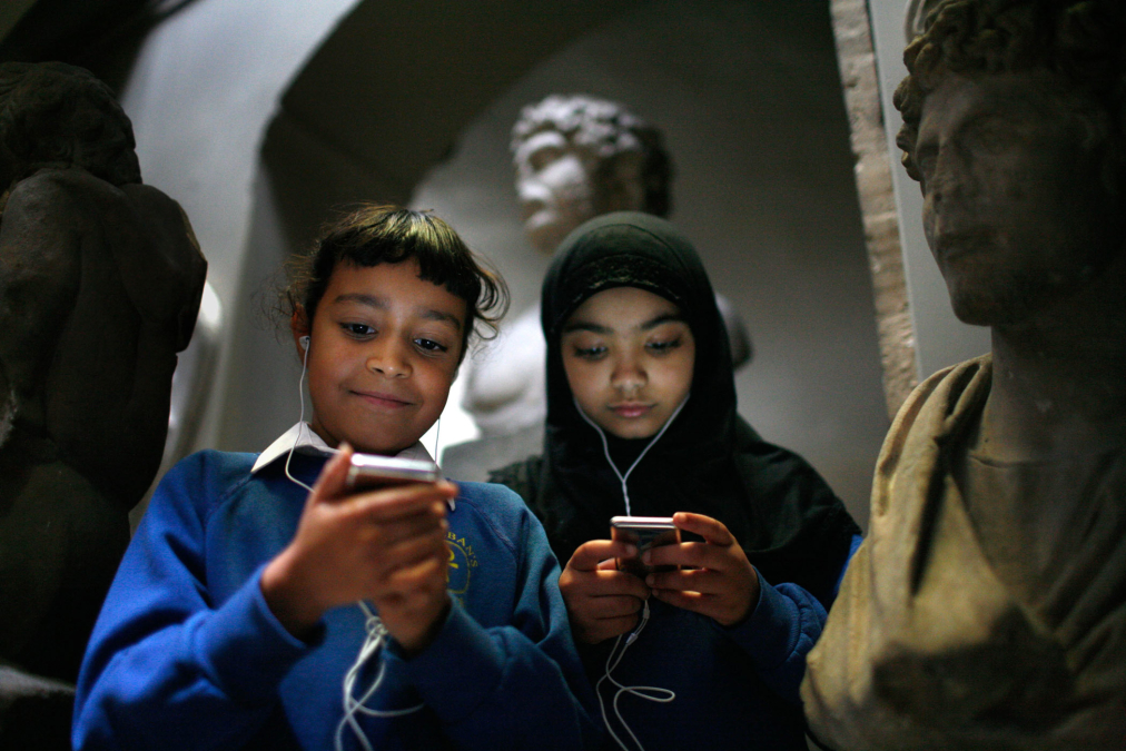 Schoolchildren with ipods Sir John Soane's Museum.