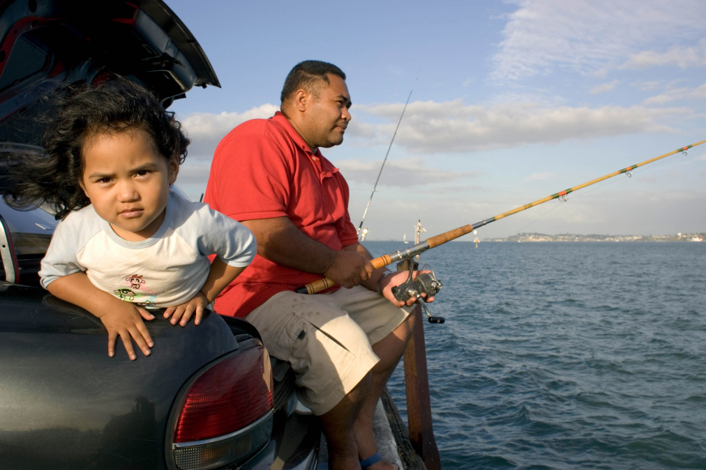 Fishing from car boot, Auckland Harbour.