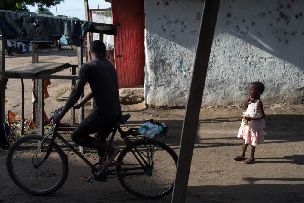 Cyclist and Girl in Pink, Baraka, DR Congo.